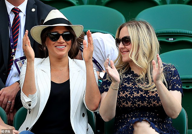 15758090-7223441-At_Wimbledon_Meghan_wearing_Ms_Swann_s_iconic_jewellery_looked_i-a-5_1562576441044